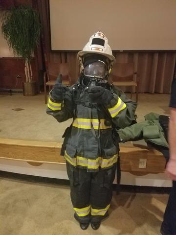 woman in firefighter gear